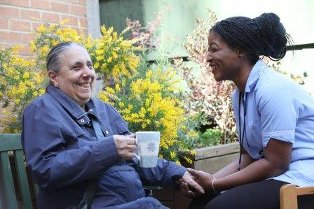 Carer and resident at Peter Shore Court