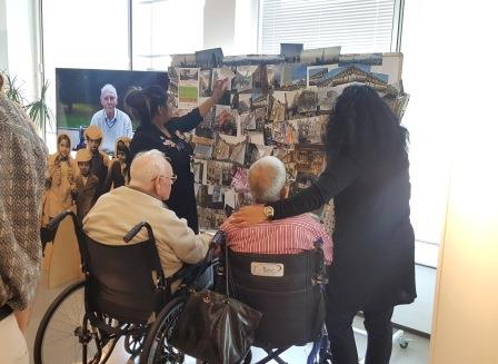 Care home visitors view the artwork