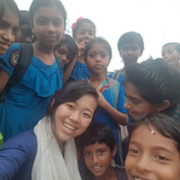 Photo of Sindy San and Bangladesh school children
