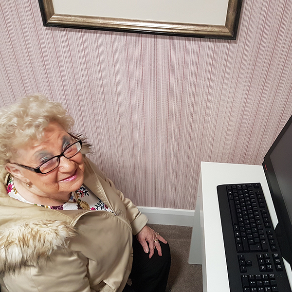 Here's Irene enjoying the new PC at William Cubitt Lodge, that was installed recently.